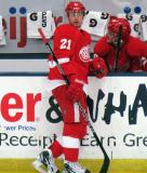 Tomas Tatar stands at the bench next to Gustav Nyquist during a stop in the Red and White Game.