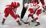 Henrik Zetterberg of Team Red and Valtteri Filppula of Team White face off against each other during the Red and White Game.