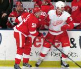 Niklas Kronwall of Team Red and Mike Knuble of Team White come together along the boards during the Red and White Game.
