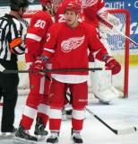 Jordin Tootoo stands in the defensive zone during a stop in play in the Red and White Game, with Drew Miller skating behind him.
