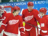Mitch Callahan, Tomas Jurco and Chad Billins talk during a stop in play in the Red and White Game.