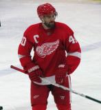 Henrik Zetterberg checks his stick during a stop in play in the Red and White Game.