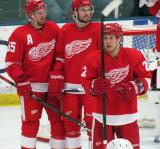 Niklas Kronwall, Drew Miller and Jordin Tootoo wait for a faceoff during a stop in play in the Red and White Game.