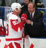 Johan Franzen is interviewed at the bench by FSD's John Keating during a stop in play in the Red and White Game.