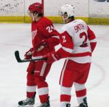 Damien Brunner of Team Red and Brendan Smith of Team White jostle for position during the Red and White Game.
