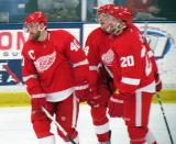 Henrik Zetterberg, Damien Brunner and Drew Miller skate back to the bench after a Zetterberg goal during the Red and White Game.