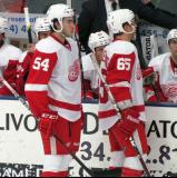 Trevor Parkes and Luke Glendening stand at the bench during a stop in play in the Red and White Game.