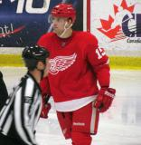 Riley Sheahan skates across the ice during a stop in play in the Red and White Game.