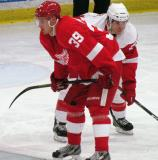 Jan Mursak of Team Red and Jeff Hoggan of Team White set set on wing for a faceoff during the Red and White Game.