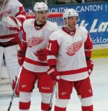 Brendan Smith and Daniel Clearly coordinate on a faceoff during the Red and White Game.