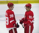 Jan Mursak and Tomas Tatar talk during a stop in play in the Red and White Game.