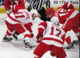 Landon Ferraro of Team White, with Patrick Eaves on his wing, takes a faceoff against Riley Sheahan of Team Red during the Red and White Game.