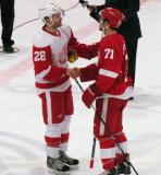 Carlo Colaiacovo and Nathan Paetsch shake hands at the end of the Red and White Game.