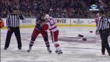 Jordin Tootoo and Columbus' Jared Boll fight off the opening faceoff.