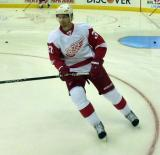 Mikael Samuelsson skates through the bottom of the right faceoff circle during pre-game warmups.