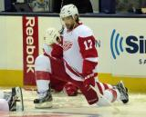 Patrick Eaves stretches along the boards during pre-game warmups.