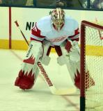 Jimmy Howard crouches at the side of the net during a slow period in pre-game warmups.