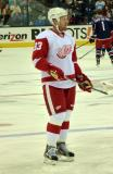 Johan Franzen stands inside the blue line during pre-game warmups.