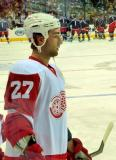 Kyle Quincey stands along the boards during pre-game warmups.