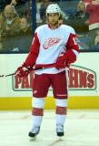 Patrick Eaves stands near the boards during pre-game warmups.