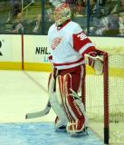 Tom McCollum stands in net during pre-game warmups.