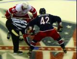 Henrik Zetterberg takes a faceoff against Columbus' Artem Anisimov.