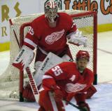 Jimmy Howard looks around Niklas Kronwall during pre-game warmps.
