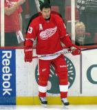 Pavel Datsyuk stands along the boards during pre-game warmps.