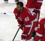 Henrik Zetterberg crouches at center ice during pre-game warmps.