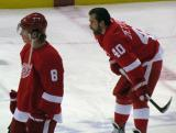 Justin Abdelkader and Henrik Zetterberg stand at center ice during pre-game warmps.