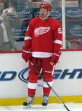 Johan Franzen stands along the boards during pre-game warmps.