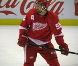 Niklas Kronwall recoils from a shot during pre-game warmps.