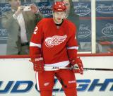 Brendan Smith stands along the boards during pre-game warmps.