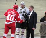 Henrik Zetterberg shakes hands with Tomas Holmstrom after a ceremonial faceoff between Zetterberg and Dallas captain Brendan Morrow on the night of Holmstrom's retirement.