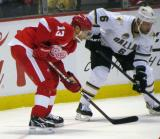 Pavel Datsyuk lines up for a faceoff alongside Dallas' Trevor Daley.