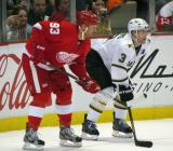 Johan Franzen lines up next to Stephane Robidas for a faceoff.