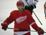 Drew Miller skates back to the bench during a stop in play.