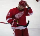 Daniel Cleary adjusts his helmet during a stop in play.
