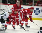 Former Red Wing Ray Whitney lines up against Drew Miller on a faceoff, with Brian Lashoff on defense and Jimmy Howard in goal for Detroit.