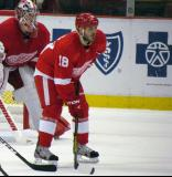 Ian White sets up for a faceoff, with Jimmy Howard over his shoulder.