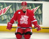 Triston Grant kneels on the ice during pre-game warmups before a Grand Rapids Griffins game.