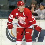 Brennan Evans crouches along the boards during pre-game warmups before a Grand Rapids Griffins game.