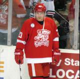 Triston Grant stands along the boards during pre-game warmups before a Grand Rapids Griffins game.