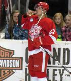 Tomas Tatar takes a drink while standing at the bench during pre-game warmups before a Grand Rapids Griffins game.