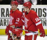 Gustav Nyquist and Joakim Andersson talk to each other during pre-game warmups before a Grand Rapids Griffins game.