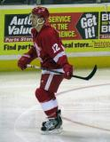 Brent Raedeke skates back to the bench during a stop in play in a Grand Rapids Griffins game.