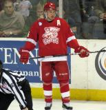 Nathan Paetsch stands along the boards during a stop in play in a Grand Rapids Griffins game.