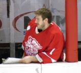 Backup goalie Jordan Pearce sits at the bench during a Grand Rapids Griffins game.