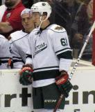 Tyler Cuma of the Houston Aeros stands at the boards during a stop in play in a game against the Grand Rapids Griffins.