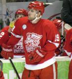 Riley Sheahan stands at the bench during a stop in play in a Grand Rapids Griffins game.